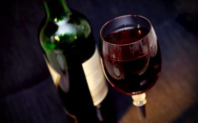 Glass and bottle of red wine