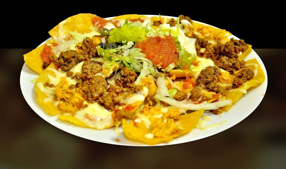 Nachos with mince meat and melted cheese